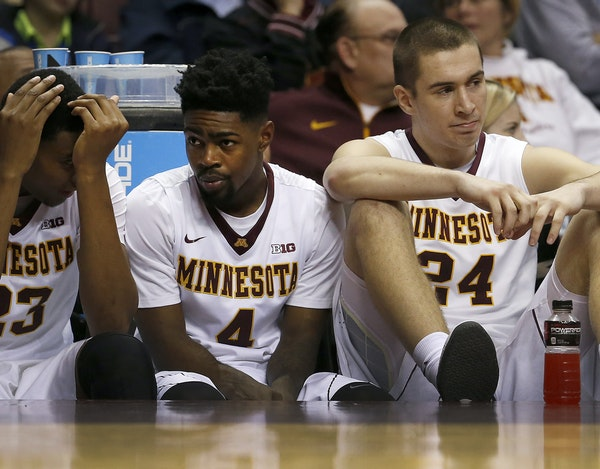 This scene on the Gophers' bench near the end of losses has been all too familiar this season. From left are Charles Buggs, Kevin Dorsey and Joey Ki