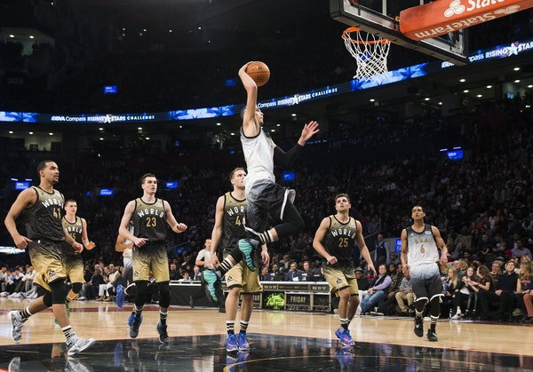 United States' Zach LaVine dunks in front of World players during the second half of the NBA Rising Stars Challenge basketball game in Toronto on Frid