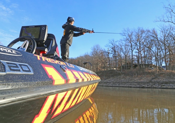 """Trevor Lo practiced Wednesday for this weekend's Bassmaster Classic on Grand Lake. His boat was unlike any other, emblazoned with """"University of Minne"""