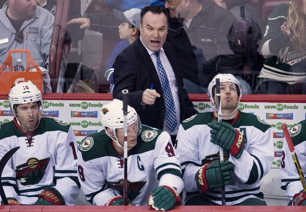 Wild interim coach John Torchetti gave instructions on the bench during his debut Monday night at Vancouver.