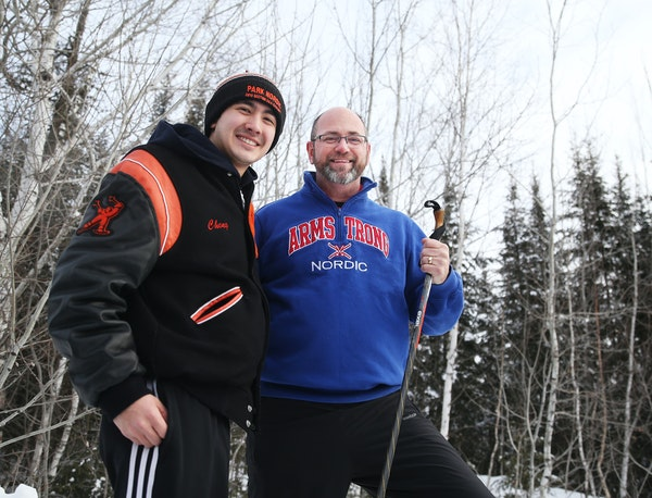 Armstrong High ski coach Doug Hubred, right, came to the aid of Ben Chong of rival St. Louis Park during a ski race.