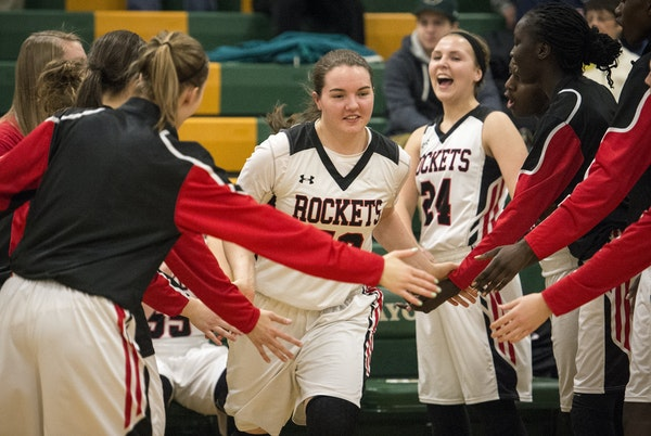 Rochester John Marshall forward Jamie Ruden (52) is part of a big group of talented Minnesota high school basketball players, a few of whom drew recru