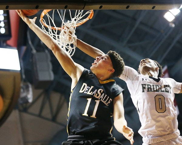 Gabe Kalscheur of DeLaSalle scored on a layup over Shyheem Murray of Fridley at Williams Arena Wednesday March 9, 2016 in Minneapolis. DeLaSalle playe