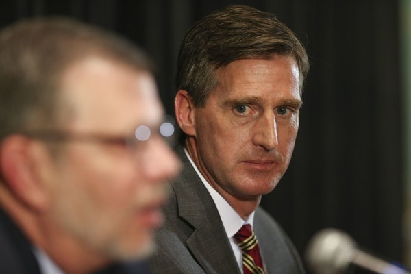 Mark Coyle, shown with University of Minnesota President Eric Kaler, was introduced as the Gophers' new top athletic official at a news conference Wed