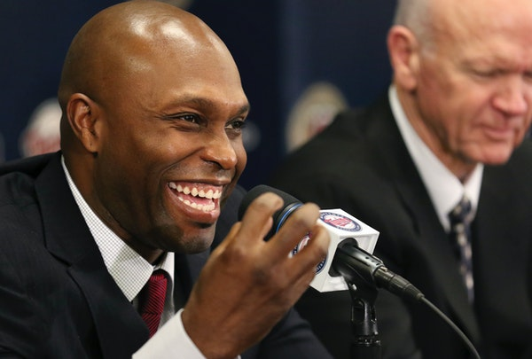 Former Twins outfielder Torii Hunter with Twins General Manager Terry Ryan. Hunter plans on returning to the Twin Cities next month when the Red Sox a