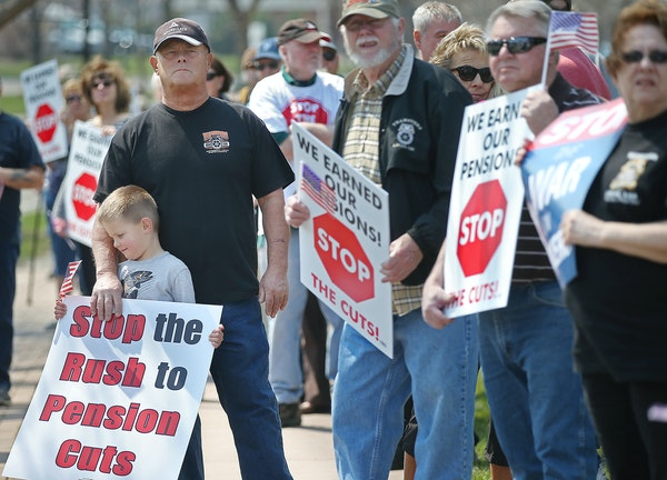 Perry Martin, who worked more than 30 years for a cement company, held onto his grandson Austin Martin, 5, as they joined other Teamsters for a rally