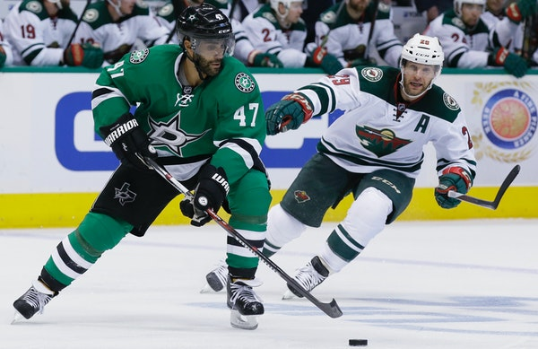 Dallas Stars defenseman Johnny Oduya (47) skates with the puck against Minnesota Wild right wing Jason Pominville (29)