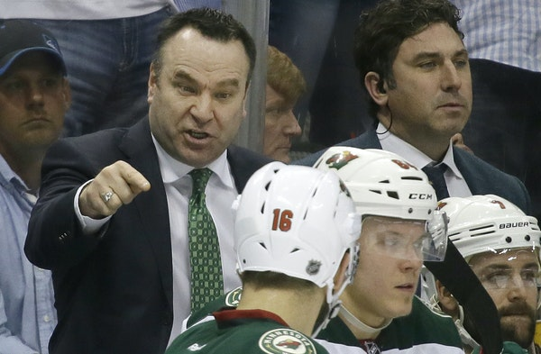 Wild interim coach John Torchetti, left, made a point to slumping left wing Jason Zucker (16) during the third period of a Game 1 defeat.