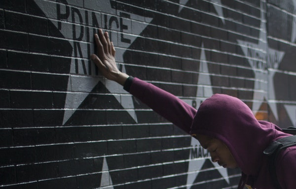 Terrance May, a musician with the name May Millions, was devastated as he visited a memorial set up for Prince at his star at First Avenue on Thursday