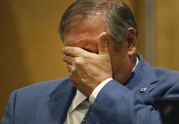 Senate Majority Leader Thomas M. Bakk (DFL) District 03 rubbed his face during the final day of the session.