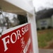"""FILE - This Jan. 26, 2016 file photo shows a """"For Sale"""" sign hanging in front of an existing home in Atlanta. Short of savings and burdened by debt, A"""