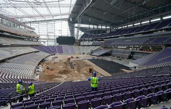 Members of the media take in a tour, Tuesday, Feb. 16, 2016, of the new U.S. Bank stadium in Minneapolis which will be home to the Minnesota Vikings N
