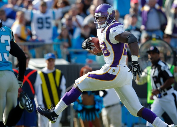 Vikings running back Adrian Peterson ran after a catch for a touchdown in 2011.