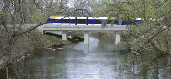 Key findings from review • New bridges and train traffic will reduce light and add noise in Minneapolis' Kenilworth Lagoon, requiring a short wall