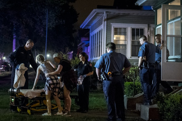 A friend helped an underage and dangerously intoxicated partygoer onto a gurney after a house party the two were attending was broken up by St. Paul p