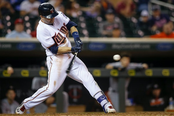 Minnesota Twins' Brian Dozier hits a two-run home run against the Miami Marlins in the 11th inning of a baseball game Tuesday, June 7, 2016, in Minnea