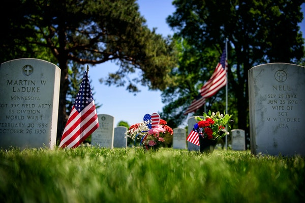 Flowers left for a loved one at Fort Snelling National Cemetery on Thursday.