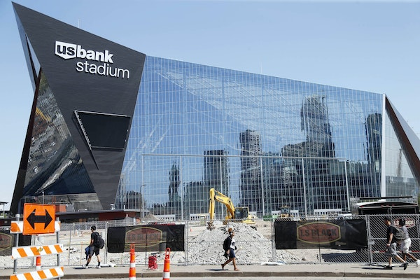 The Minneapolis skyline is reflected in the new U.S. Bank Stadium in Minneapolis as it nears completion for the $1.2 billion home of the Minnesota Vik
