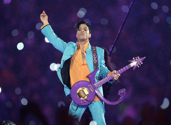 In this 2007 file photo, Prince performs during the halftime show at the Super Bowl XLI football game at Dolphin Stadium in Miami.
