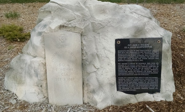 A new memorial plaque in Richfield explains how a typo (shown on the original headstone) accidentally sent Union sharpshooter John Dolson's bones to