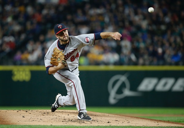 Minnesota Twins starting pitcher Pat Dean in action against the Seattle Mariners in a baseball game Friday, May 27, 2016, in Seattle. (AP Photo/Elaine