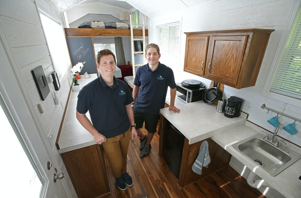 New Brighton entrepreneurs John Louiselle, left, and Jesse Lammi founded NextDoor Housing, a company that produces small, handicap-accessible mobile h