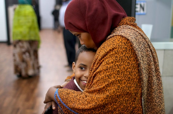 Ayan Farah, the mother of defendant Mohamed Farah, 22, hugged her youngest son Abdirahmin, 9, outside the family's restaurant Friday after Mohamed Far