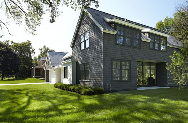 The three-level home is a modern updated version of traditional cottage-style in Cottagewood, an established neighborhood on Lake Minnetonka.