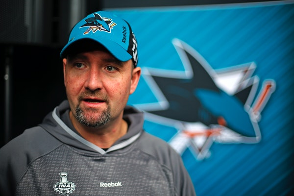 San Jose Sharks head coach Peter DeBoer talks with a reporter during Stanley Cup Finals media day in Pittsburgh, Sunday May 29, 2016. The Sharks face