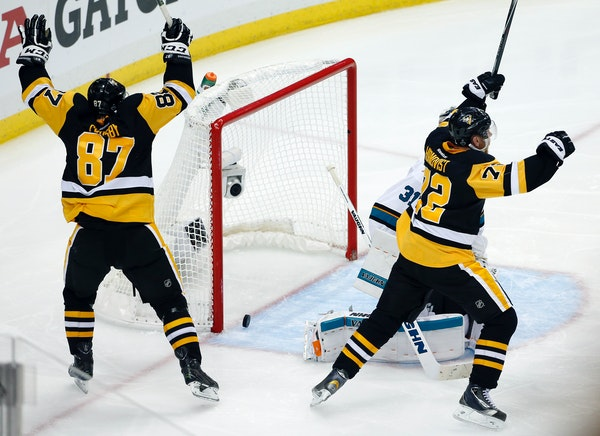 Pittsburgh Penguins' Sidney Crosby (87) and Patric Hornqvist, right, celebrate a goal by Conor Sheary against San Jose Sharks goalie Martin Jones (31)