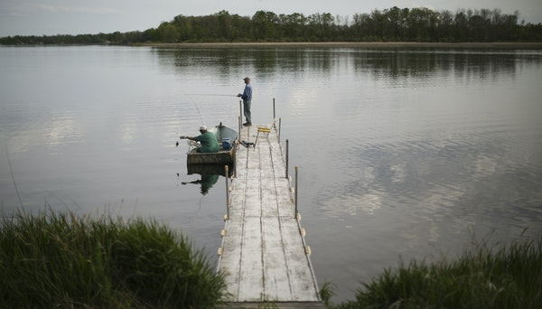 Guests at Lakecrest Resort on Long Lake fished off one of the docks. Amy Wolf and her husband, Kregg, bought the Detroit Lakes resort in January and h