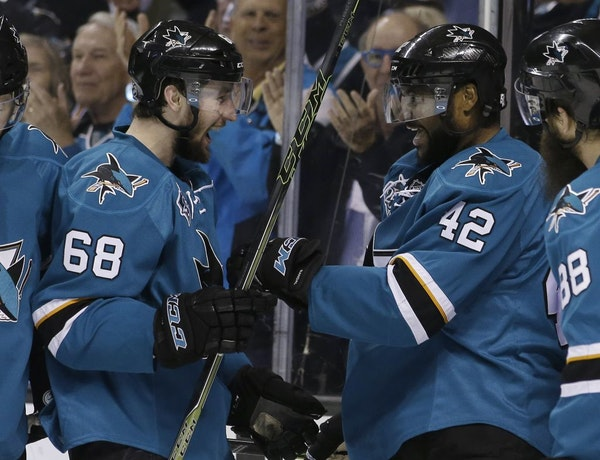 San Jose Sharks' Joel Ward (42) celebrates his goal with teammate Melker Karlsson (68) during the second period in Game 6 of the NHL hockey Stanley Cu