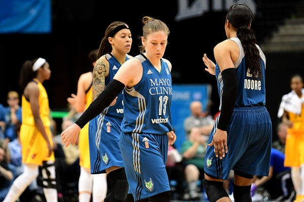 Minnesota Lynx guard Lindsay Whalen (13) and other teammates weren't overly jubilant after an ugly 74-71 finish against the Indiana Fever.
