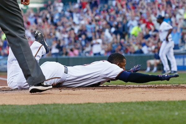 Minnesota Twins' Eduardo Nunez slides safely into home to score on an inside-the-park home run off Tampa Bay Rays pitcher Matt Moore during the first