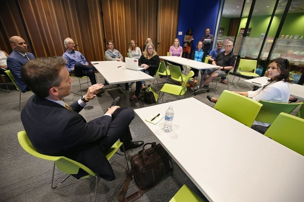 Ed Graff, the outgoing superintendent of Anchorage schools, left, and Minnesota Education Commissioner Brenda Cassellius, right, joined for a meet and