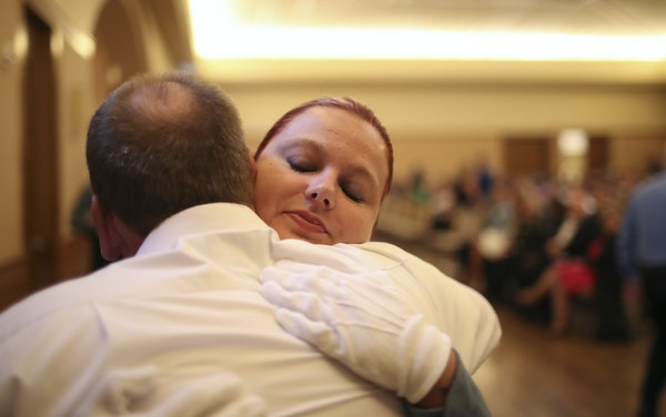Meghan Smelter hugged her father, retired Minneapolis police officer Greg Smelter, after he pinned her badge on her uniform Wednesday.