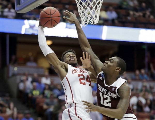 Oklahoma guard Buddy Hield shot over Texas A&M guard Jalen Jones during the first half of an NCAA regional semifinal game. Hield could be an attractiv