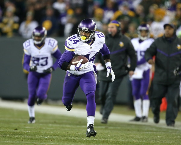 Vikings cornerback Captain Munnerlyn saw no one to stop him after picking up an Aaron Rodgers fumble forced by Everson Griffen. Munnerlyn's 55-yard