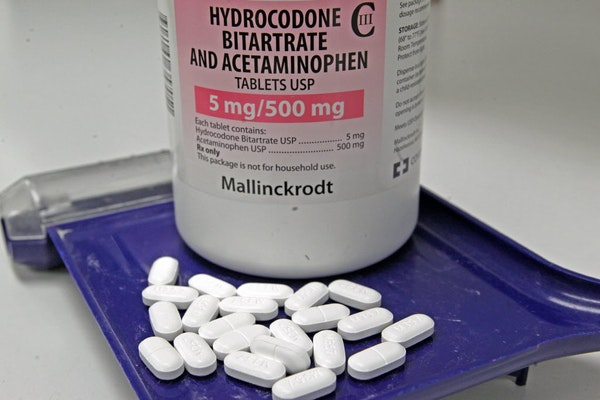 Hydrocodone bitartrate and acetaminophen pills, also known as Vicodin. Leftover pills might even be in your medicine cabinet right now — even if the