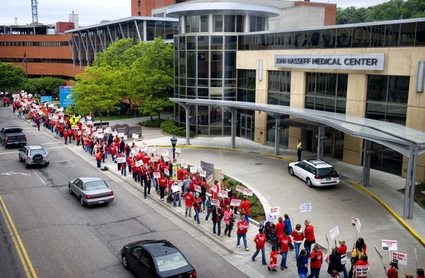 In May, members of the Minnesota Nurses Association did an informational picket outside Allina's United Hospital in St. Paul.