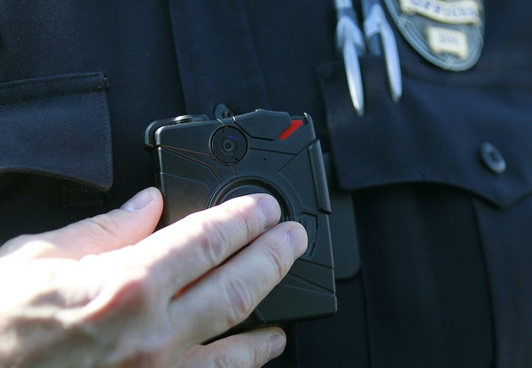 Police organizations fought for restrictive new rules for departments using body cameras.