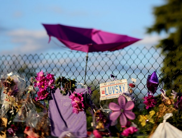 An umbrella and D.C. license plate left behind as a memento by Prince fans outside Paisley Park Sunday May 15, 2016, in Chanhassen. Work began Friday