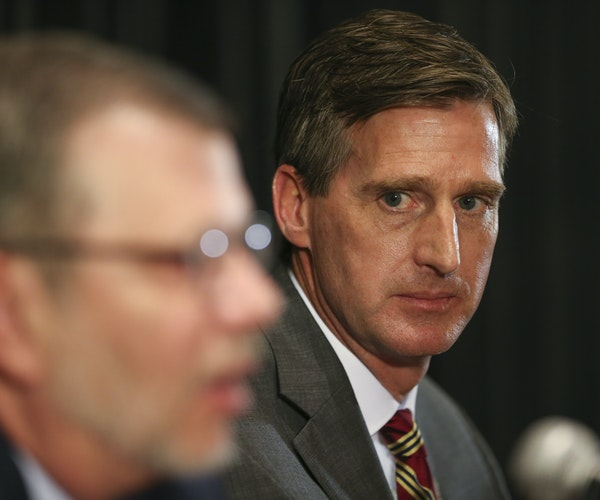 Former Syracuse athletic director Mark Coyle, shown with President Eric Kaler, arrives this week to take the helm as the new AD for the University of