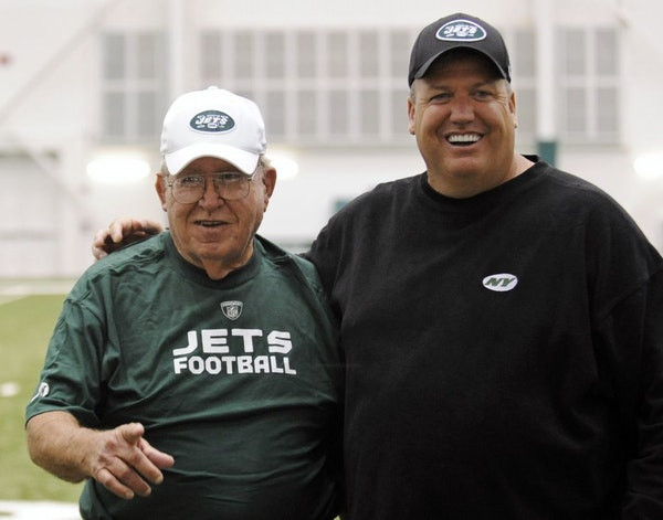 FILE - In tis June 6, 2009, file photo, New York Jets head coach Rex Ryan, right, poses for photographers with his father, Buddy, at the NFL football