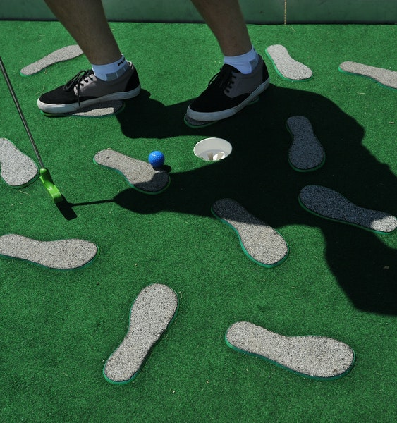 Players stood on the foot pedestals while putting at Walker Art Center's Mini-Golf in 2013.