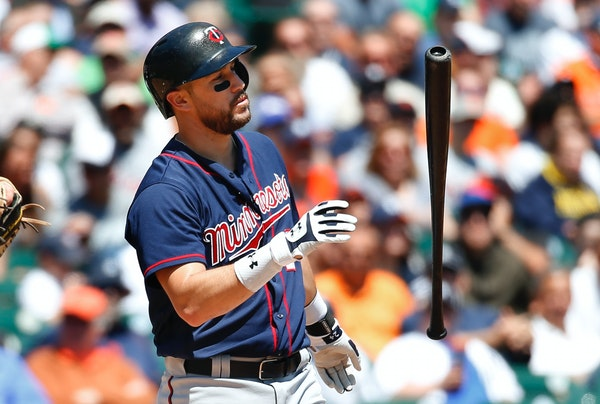 Minnesota Twins' Trevor Plouffe flips his bat after striking out against the Detroit Tigers in the fourth inning of a baseball game in Detroit, Wednes