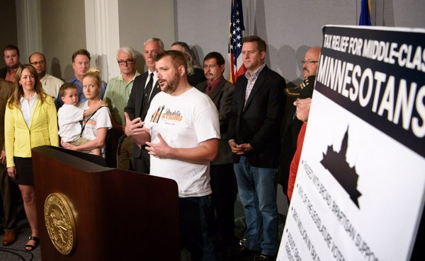 Ryan Visher, who lost his floral shop in the Madelia fire, says during a news conference that he needs the relief provided in the tax bill, Monday, Ju
