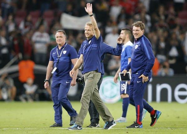 Saturday's CONCACAF Cup match against Mexico could be crucial for U.S. head coach Jurgen Klinsmann, waving.