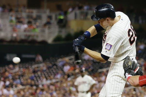 Minnesota Twins' Max Kepler hits an RBI single off Philadelphia Phillies pitcher Adam Morgan during the fifth inning of a baseball game Wednesday, Jun