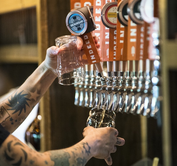 On tap: Heather Kraft poured a glass at Indeed Brewing. There were 105 craft breweries in the state last year, only 40 in 2011.